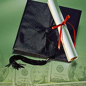 Mortarboard , diploma and money © Comstock, Getty Images