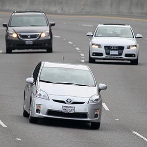 A Toyota Prius drives along highway 101 on November 30, 2010 in Sausalito, Calif. (© Justin Sullivan/Getty Images)
