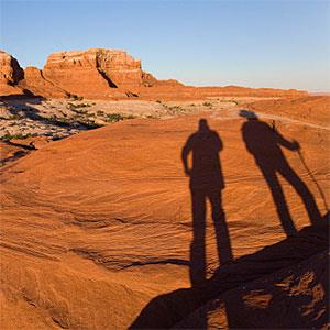 Shadow of hikers on sandstone © Walter Hodges, Photodisc, Getty Images