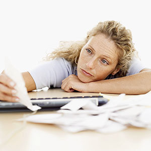 Woman with paperwork © Getty Images