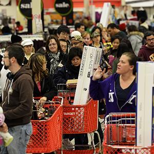 Credit: © Erik S. Lesser/EPACaption: Customers wait in line at a Target store in Atlanta, Ga.
