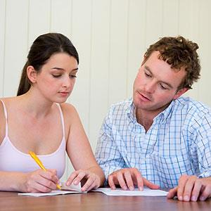 Couple with paperwork © IT Stock Free, Jupiterimages