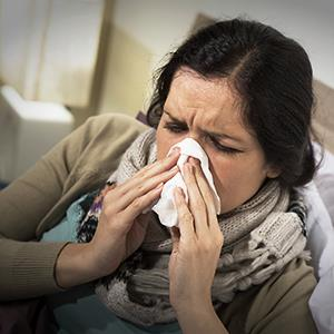 Woman with the flu © CandyBoxImages/Getty Images