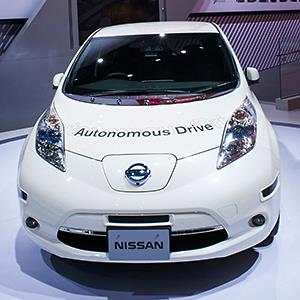 A Nissan Leaf outfitted as an autonomous drive vehicle on display at the North American International Auto Show© Jim West/Alamy