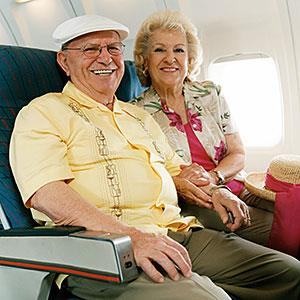 Senior Couple Sitting Together on a Plane © Digital Vision/Getty Images